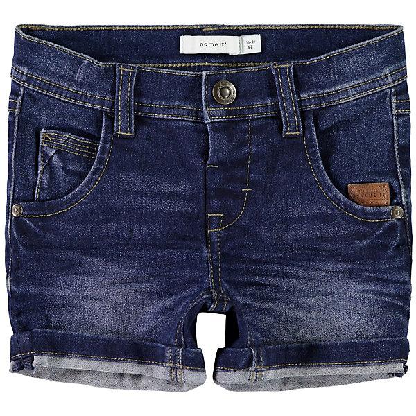 Шорты Name ItШорты<br>Характеристики товара:<br><br>• состав ткани: 72% хлопок, 26% полиэстер, 2% эластан<br>• сезон: лето<br>• застёжка: пуговица<br>• особенности: джинсовые<br>• шлёвки для ремня<br>• классическая пятикарманная модель<br>• страна бренда: Дания<br><br>Шорты в виде укороченных джинсов. Штанины можно отвернуть. Передние карманы декорированы клёпками, есть нашивка с надписью бренда.