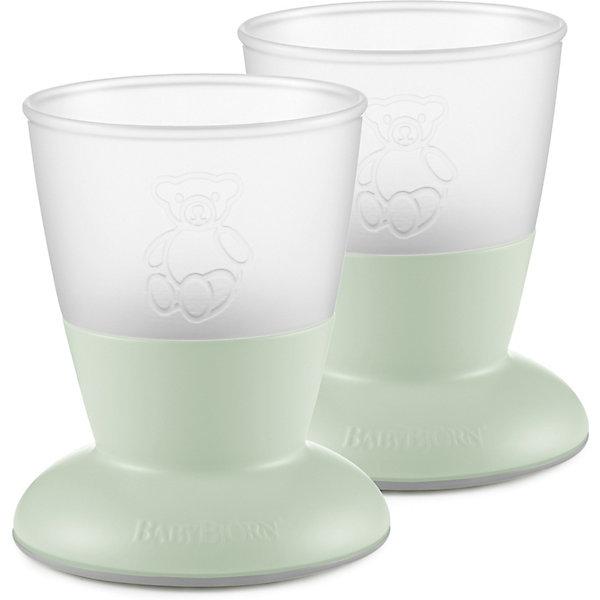 Набор кружек BabyBjornДетская посуда<br>Характеристики:<br><br>• в комплекте: 2 стаканчика<br>• сертификация материалов<br>• материал: полипропилен (ПП) и термоэластопласт (ТЭП)<br>• не содержит бисфенол-А (BPA free)<br>• не скользят по поверхности стола<br>• сложно опрокинуть<br>• можно мыть в посудомоечной машине и ставить в морозилку<br>• вес кружки: 70 гр<br>• размеры кружки:  74х74х86 см<br>• объём кружки: 100 мл<br>• практичная маркировка, указывающая объём в мл<br><br>Благодаря особой форме и материалу кружку легко удерживать маленькой ручкой. <br>Ребенку будет сложно ее опрокинуть, благодаря тому, что центр тяжести расположен низко, и кружка имеет широкое массивное основаниес резиновой подкладкой. Содержимое чашки и его количество легко увидеть сквозь матовый пластик.<br><br>Все изделия соответствуют европейским и американским стандартам безопасности. Материалы проходят сертификацию на безвредность для пищевых продуктов.