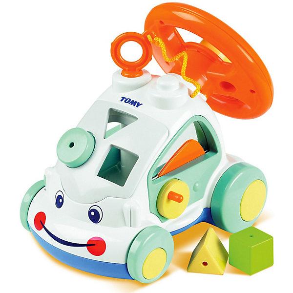 Интерактивный автомобиль, TOMYИдеи подарков<br>Интерактивный автомобиль, Tomy (Томи) - красочная развивающая игрушка, которая наверняка понравится Вашему ребенку. У машинки забавная улыбающаяся мордашка, в корпусе, который можно использовать как сортер, имеются фигурные прорези для разноцветных формочек (входят в комплект). При движении колеса издают характерный звук трещотки.<br>Сзади расположен большой крутящийся руль с крупной кнопкой-клаксоном, нажав на нее малыш услышит автомобильный гудок, а поворот руля будет сопровождаться веселым потрескиванием. Правая дверца машинки открывается с помощью ручки, а на левой дверке снаружи есть рычажок, который имитирует опускание бокового стекла. Автомобиль округлой формы с крупными деталями, малышу будет удобно хватать его и катать по полу. Игрушка способствует развитию логики, мелкой моторики и координации движений.<br><br>Дополнительная информация:<br><br>-Материал: пластмасса.<br>-Размер упаковки: 28 х 17 х 24 см.<br>-Вес: 1 кг.<br><br>Интерактивный автомобиль, Tomy (Томи), можно купить в нашем интернет-магазине.<br>Ширина мм: 280; Глубина мм: 170; Высота мм: 240; Вес г: 1000; Возраст от месяцев: 12; Возраст до месяцев: 36; Пол: Унисекс; Возраст: Детский; SKU: 3950203;