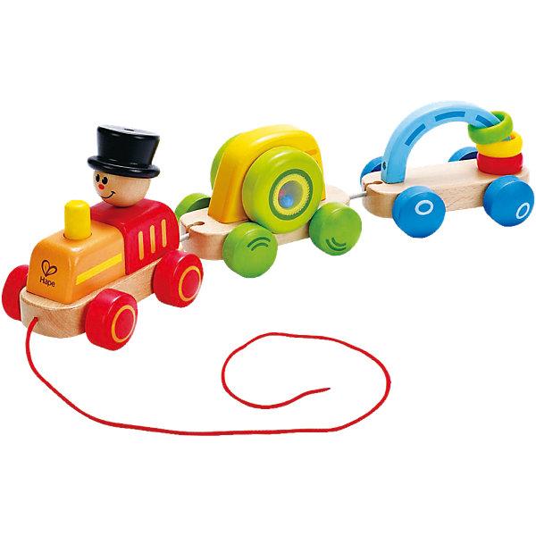 Каталка Паровозик, HapeДеревянные игрушки<br>Каталка Паровозик, Hape (Хейп).<br><br>Характеристики:<br><br>- Материал: древесина, краска на водной основе, PC, PE<br>- Размер: 8,8х8,8х16 см.<br><br>Игровой набор состоит из паровозика и 2-х вагонов, которые можно отсоединять друг от друга и играть отдельно. У паровозика длинная веревка, с помощью которой малышу удобно катать игрушку. Внутри первого вагона находятся разноцветные шарики, они весело гремят при движении. У второго вагона есть арка, на которую нанизаны разноцветные колечки, их можно перекидывать с одной стороны арки на другую. Яркие цвета и подвижные элементы привлекают внимание малыша, побуждают к изучению и движению, также игрушка способствует развитию моторики, координации.<br><br>Каталку Паровозик, Hape (Хейп) можно купить в нашем интернет-магазине.<br>Ширина мм: 421; Глубина мм: 187; Высота мм: 96; Вес г: 858; Возраст от месяцев: 12; Возраст до месяцев: 24; Пол: Унисекс; Возраст: Детский; SKU: 4141516;