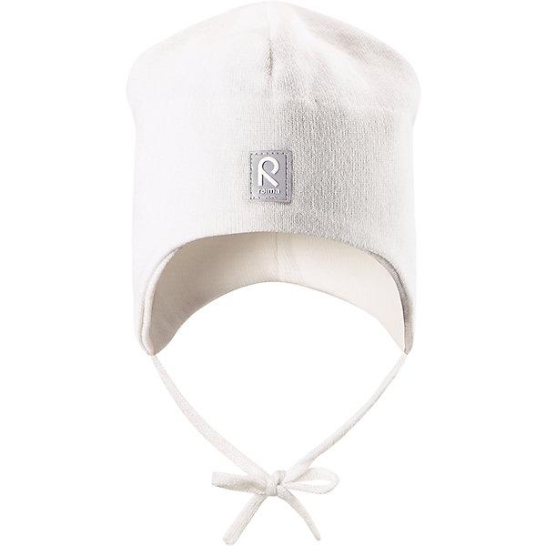 Шапка Aqueous ReimaШапки и шарфы<br>Характеристики товара:<br><br>• цвет: белый<br>• состав: 100% хлопок<br>• полуподкладка: хлопковый трикотаж<br>• температурный режим: от 0С до +10С<br>• эластичный хлопковый трикотаж<br>• инделие сертифицированно по стандарту Oeko-Tex на продукция класса 1 - одежда для новорождённых<br>• ветронепроницаемые вставки в области ушей<br>• завязки во всех размерах<br>• эмблема Reima спереди<br>• светоотражающие детали<br>• страна бренда: Финляндия<br>• страна производства: Китай<br><br>Детский головной убор может быть модным и удобным одновременно! Стильная шапка поможет обеспечить ребенку комфорт и дополнить наряд. Шапка удобно сидит и аккуратно выглядит. Проста в уходе, долго служит. Стильный дизайн разрабатывался специально для детей. Отличная защита от дождя и ветра!<br><br>Уход:<br><br>• стирать по отдельности, вывернув наизнанку<br>• придать первоначальную форму вo влажном виде<br>• возможна усадка 5 %.<br><br>Шапку от финского бренда Reima (Рейма) можно купить в нашем интернет-магазине.<br>Ширина мм: 89; Глубина мм: 117; Высота мм: 44; Вес г: 155; Цвет: белый; Возраст от месяцев: 9; Возраст до месяцев: 18; Пол: Унисекс; Возраст: Детский; Размер: 48,46,50,52; SKU: 5271115;