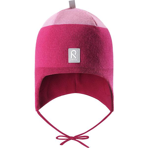 Шапка Reima Auva для девочкиШапки и шарфы<br>Характеристики товара:<br><br>• цвет: фуксия;<br>• состав: 100% шерсть;<br>• подкладка: 100% полиэстер, флис;<br>• температурный режим: от 0 до -20С;<br>• сезон: зима; <br>• особенности модели: вязаная, на подкладке, на завязках;<br>• мягкая ткань из мериносовой шерсти для поддержания идеальной температуры тела;<br>• сплошная подкладка: мягкий флис;<br>• ветронепроницаемые вставки в области ушей;<br>• светоотражающая эмблема;<br>• логотип Reima спереди;<br>• страна бренда: Финляндия;<br>• страна изготовитель: Китай.<br><br>Вязаная шапка на завязках для малышей из мериносовой шерсти подарит уют в морозную погоду: мягкая подкладка из флиса обеспечит ребенку тепло и комфорт. Шерстяная шапка с флисовой подкладкой идеально подходит для маленьких любителей приключений на свежем воздухе, ведь флис быстро сохнет и выводит влагу. <br><br>За счет эластичной вязки шапка отлично сидит, а ветронепроницаемые вставки в области ушей защищают ушки от холодного ветра. Благодаря завязкам эта стильная шапка не съезжает и хорошо защищает голову. Создайте стильный теплый образ: сочетайте шапку с горловиной Star.<br><br>Шапка Auva Reima от финского бренда Reima (Рейма) можно купить в нашем интернет-магазине.<br>Ширина мм: 89; Глубина мм: 117; Высота мм: 44; Вес г: 155; Цвет: розовый; Возраст от месяцев: 9; Возраст до месяцев: 12; Пол: Женский; Возраст: Детский; Размер: 46,52,50,48; SKU: 6907036;