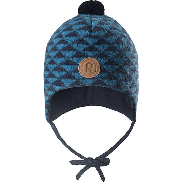 Шапка Reima Kauris для мальчикаШапки и шарфы<br>Характеристики товара:<br><br>• цвет: синий;<br>• состав: 100% шерсть;<br>• подкладка: 97% хлопок, 3% эластан;<br>• температурный режим: от 0 до -20С;<br>• сезон: зима; <br>• особенности модели: вязаная, шерстяная;<br>• шерсть идеально поддерживает температуру;<br>• ветронепроницаемые вставки в области ушей;<br>• сплошная подкладка: гладкий хлопковый трикотаж;<br>• шапка на завязках, помпон сверху;<br>• логотип Reima спереди;<br>• страна бренда: Финляндия;<br>• страна изготовитель: Китай.<br><br>Зимняя шерстяная шапка из красивого, бархатного на ощупь материала не боится мороза! Шапка связана из шерсти, которая является идеальным терморегулятором, и подшита приятной на ощупь хлопковой подкладкой. Ветронепроницаемые вставки в области ушей и завязки надежно защитят от холодного ветра. <br><br>Шапку Kauris Reima от финского бренда Reima (Рейма) можно купить в нашем интернет-магазине.<br>Ширина мм: 89; Глубина мм: 117; Высота мм: 44; Вес г: 155; Цвет: синий; Возраст от месяцев: 36; Возраст до месяцев: 48; Пол: Мужской; Возраст: Детский; Размер: 50,52,48,46; SKU: 6907201;