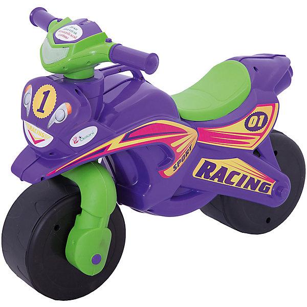 """Каталка-байк музыкальный """"Sport"""", фиолетово-зеленый, DoloniМотоциклы<br>Характеристики товара:<br><br>• возраст: от 3 лет;<br>• максимальная нагрузка: 40 кг;<br>• материал: пластик;<br>• высота до сидения: 32 см;<br>• тип батареек: 2 батарейки АА;<br>• наличие батареек: в комплекте;<br>• размер упаковки: 70х35х50 см;<br>• вес упаковки: 2,9 кг;<br>• страна производитель: Украина.<br><br>Каталка-байк Sport Doloni фиолетово-зеленая выполнена в виде мотоцикла на колесах и с рулем. Каталка позволит детям весело и активно провести время на прогулке. Сидя на ней, ребенок отталкивается ножками от земли и едет вперед, что способствует физическому развитию, учит держать равновесие.<br><br>На руле расположены кнопки для активации звуковых и световых эффектов. При нажатии кнопок загорается фара, раздаются звук мотора мотоцикла и сирены полицейской машины. Прорезиненные колеса обеспечивают бесшумное катание. Для мамы предусмотрена удобная ручка для переноски каталки.<br><br>Игрушка выполнена из качественного безопасного пластика. На ней отсутствуют острые углы, которые могут поранить ребенка.<br><br>Каталку-байк Sport Doloni фиолетово-зеленую можно приобрести в нашем интернет-магазине.<br>Ширина мм: 700; Глубина мм: 350; Высота мм: 500; Вес г: 2900; Возраст от месяцев: 36; Возраст до месяцев: 2147483647; Пол: Унисекс; Возраст: Детский; SKU: 6963497;"""