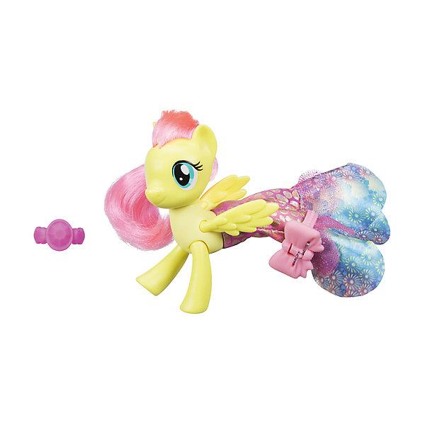 Игровой набор Hasbro My little Pony Мерцание. Пони в волшебных платьях, ФлаттершайФигурки из мультфильмов<br>Характеристики:<br><br>• в наборе представлен персонаж из серии «Мерцание;<br>• особенностью игрушки является облачение пони в волшебное платье;<br>• материал фигурки: пластик;<br>• дополнительные аксессуары позволяют разнообразить игру;<br>• фигурки можно использовать в комбинации с различными игровыми наборами MLP.<br><br>MLP «Мерцание» Пони в волшебных платьях можно купить в нашем интернет-магазине.<br>Ширина мм: 209; Глубина мм: 182; Высота мм: 58; Вес г: 131; Возраст от месяцев: 36; Возраст до месяцев: 72; Пол: Женский; Возраст: Детский; SKU: 7120210;