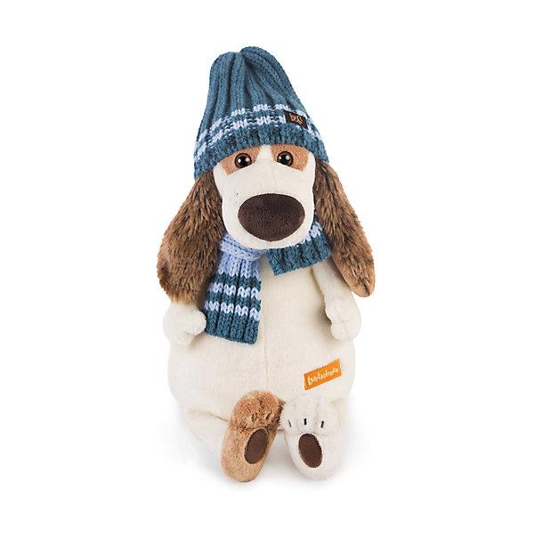 все цены на Budi Basa Мягкая игрушка Budi Basa Собака Бартоломей в голубой шапке и шарфе, 27 см онлайн