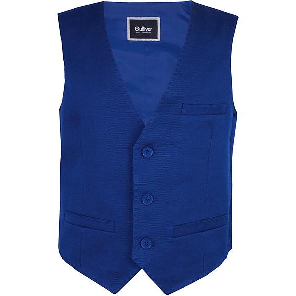 Жилет Gulliver для мальчикаВерхняя одежда<br>Характеристики товара:<br><br>• цвет: синий;<br>• состав ткани: 61% хлопок, 39% полиэстер;<br>• подкладка: 50% вискоза, 50% полиэстер;<br>• сезон: круглый год;<br>• застёжка: пуговицы;<br>• регулируемый ремешок на спине;<br>• нарядный жилет;<br>• три кармана;<br>• коллекция: Ницца;<br>• страна бренда: Россия.<br><br>В преддверии весенних праздников, выпускных мероприятий, дней рождения или выхода в свет по другому приятному поводу, купить детский жилет для мальчика становится для мамы острой необходимостью. Прекрасная форма, идеальная посадка изделия на фигуру, взрослая внутренняя обработка, не допускающая компромиссов, - стильный синий жилет будет выглядеть элегантно, подчеркнув безупречный вкус и индивидуальность ребенка!<br><br>Жилет Gulliver (Гулливер) можно купить в нашем интернет-магазине.<br>Ширина мм: 356; Глубина мм: 10; Высота мм: 245; Вес г: 519; Цвет: синий; Возраст от месяцев: 72; Возраст до месяцев: 84; Пол: Мужской; Возраст: Детский; Размер: 122,140,134,128; SKU: 7790360;