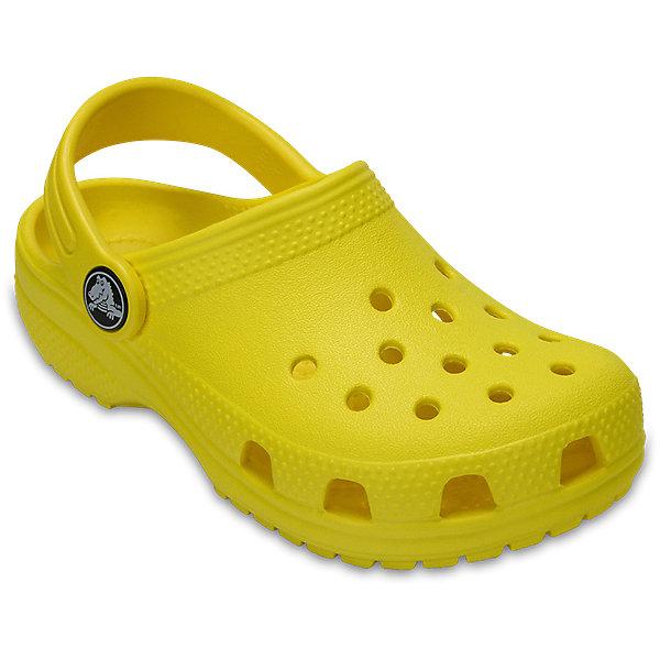 Сабо  CROCSПляжная обувь<br>Характеристики товара:<br><br>• модель: Classic Clog K<br>• цвет: желтый;<br>• состав: 100% полимер Croslite™;<br>• сезон: лето;<br>• температурный режим: от +20;<br>• модель: закрытые;<br>• застежка: пяточный ремешок;<br>• непромокаемые;<br>• вентилируемые;<br>• рельефный рисунок подошвы;<br>• анатомические;<br>• светоотражающий логотип в области пятки;<br>• страна бренда: США<br><br>Стильные сабо Crocs  придутся по душе вашему ребенку. Модель полностью выполнена из полимерного материала яркого цвета. Съемный пяточный ремешок, оформленный названием бренда, предназначен для фиксации стопы при ходьбе. Рифление на подошве гарантирует идеальное сцепление с любой поверхностью. Такие сабо - отличное решение для каждодневного использования!<br><br>Благодаря материалу Croslite обувь невероятно легкая, мягкая и удобная. Материал Croslite™ - это патентованная пена с закрытыми ячейками, обладающая удивительными свойствами. Она присутствует в каждой паре обуви Crocs™, придавая ей характерную упругость, неповторимый комфорт и ощущение свободы.<br><br>Сабо CROCS  (Крокс) можно купить в нашем интернет-магазине.<br>Ширина мм: 225; Глубина мм: 139; Высота мм: 112; Вес г: 290; Цвет: желтый; Возраст от месяцев: 12; Возраст до месяцев: 15; Пол: Унисекс; Возраст: Детский; Размер: 21,34/35,33/34,31/32,30,29,28,27,26,25,24,23,22; SKU: 7892864;
