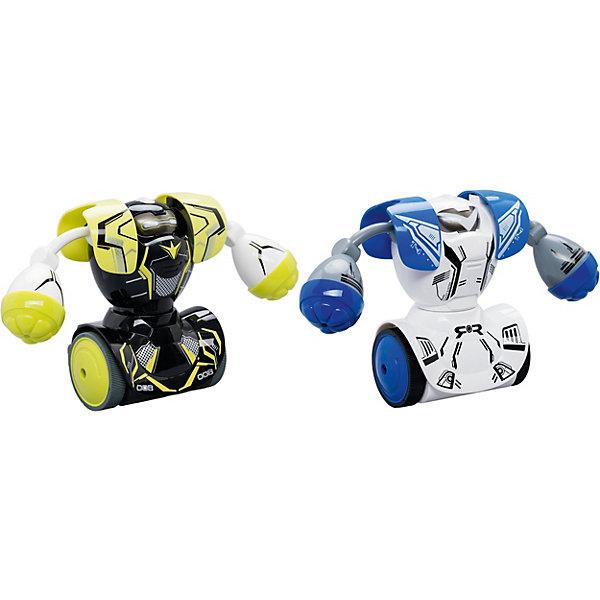 Радиоуправляемые боевые роботы Silverit РобокомбатРоботы-игрушки<br>Характеристики товара:<br><br>• возраст: от 5 лет;<br>• комплект: робот – 2 шт., пульт управления (ИК) – 2 шт.;<br>• батарейки в комплект не входят;<br>• дальность управления макс. 5м.;<br>• время игры около 40 мин.;<br>• материал: пластик;<br>• упаковка: картонная коробка;<br>• размер упаковки: 22 x 8,5 x 14,5 см..;<br>• вес: 950 гр.;<br>• наименование бренда: Silverlit.<br><br>Боевые роботы «Робокомбат» - Роботизированные игрушки на пульте управления от компании Silverlit — отличный подарок для ребенка. В этот потрясающий набор могут играть до 4 человек. Существует два режима игры: режим против игроков и режим тренировочный. У роботов есть подсветка глаз, присутствует очень четкая озвучка ударов. У каждого робота присутствует четыре направления движения.<br><br>В комплекте: робот – 2 шт., пульт управления (ИК) – 2 шт.,  инструкция – 1 шт.  ВНИМАНИЕ! Для работы требуются батарейки: 6 x AA / 4 x AAA.<br><br>Такой увлекательный набор может стать интересной темой для общения с друзьями. Сюжетные игры замечательно развивают фантазию, логическое мышление, улучшают память. <br><br>Боевые роботы «Робокомбат» от Silverlit можно купить в нашем интернет-магазине.<br>Ширина мм: 480; Глубина мм: 470; Высота мм: 300; Вес г: 3810; Возраст от месяцев: 60; Возраст до месяцев: 108; Пол: Мужской; Возраст: Детский; SKU: 8334986;